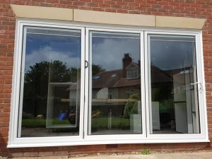 White Aluminium Bifolding doors with integral blinds