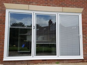 White Aluminium Bifolding doors with integral blinds.jpg