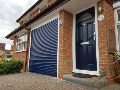 Blue Composite door and blue remote control roller garage door
