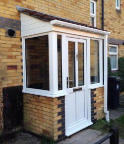 White PVCu Porch with tiled roof
