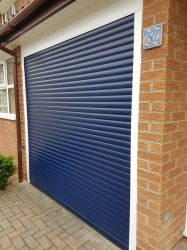 Blue remote control roller garage door